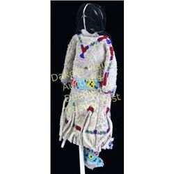 Small beaded Northern Plains Indian childs doll with finely beaded separate belt and pouch, cloth st