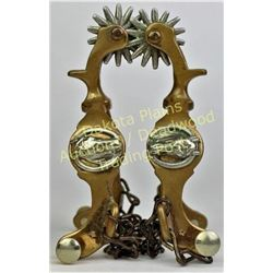 Pair star stamped horse head spurs in bronze, by Beurmann, very good condition.  Est. 150-250