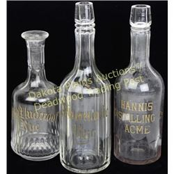 Collection of three gold leaf back bar bottles fine condition, light frosting inside of of the bottl
