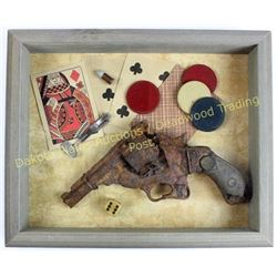 Shadow boxed relic top break revolver displayed with old gambling items.  Est. 75-100