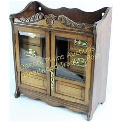 Small antique smokers tobacco cabinet oak, beveled glass double doors, fitted interior with four dra