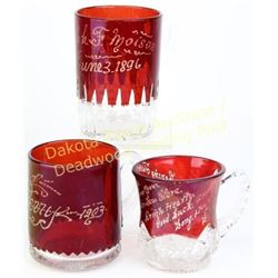 Collection of 3 early ruby stained souvenir cups with handles, etched with two dated 1896 and 1903,