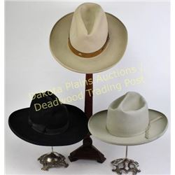 "Collection of 3 vintage felt cowboy hats including gray resistol, approximately 7.5"", black Montgome"