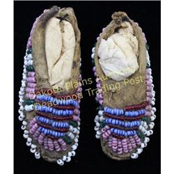 "Tiny pair Northern Plains childs toy moccasins 2"" long, sinew sewn pink, red, white, green, and blue"