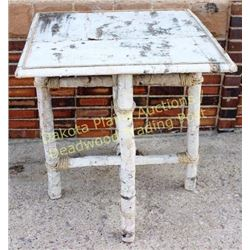 Nicely made birch bark folding table top removable, folding legs and rope accents, top trimmed in sp