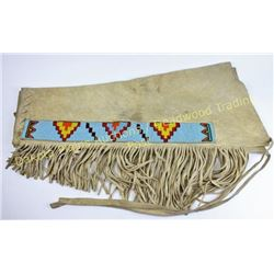 Pair contemporary beaded Plains Indian leggings fringed with bead strips on both legs, 31  long, nic