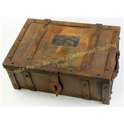 Reproduction iron strong box with brass Wells Fargo tag on lid, measuring 8 X13 X19 , an older copy