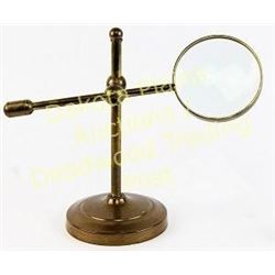 Adjustable magnifying glass solid brass table top style, unmarked, 10  tall.  Est. 100-175