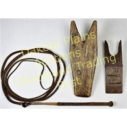 Collection of 3 includes bullwhip and 2 wooden boot jacks.  Est. 75-150