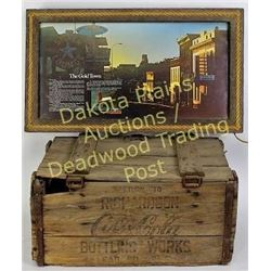 Collection of 2 includes Lead, S.D., Coca-Cola bottle crate and Lead, S.D. Main Street sign showing