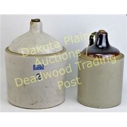 Collection of 2 stoneware whiskey jugs Est. 25-100