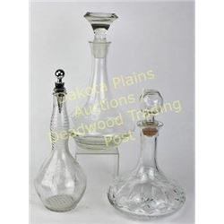 Collection of 3 glass decanters Est.  25-50