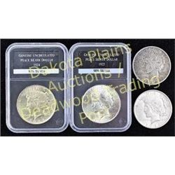 Collection of 5 coins includes 2 slabbed and uncirculated silver peace dollars 1922 and 1924, ungrad