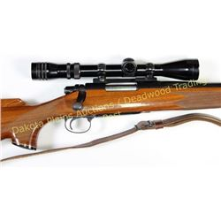 "Remington model 700 22-250 SN 6837882 bolt action rifle 24"" round barrel blue finish, checkered waln"