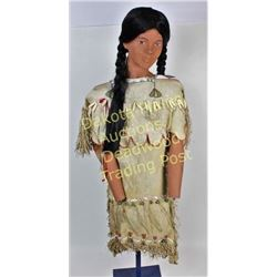 Vintage Plains Indian girls dress on mannequin from an Iowa museum display, dress beaded and fringed