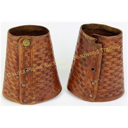 "Pair basket stamped cowwboy cuffs 5.5"" long, one missing snaps.  Est. 25-50"