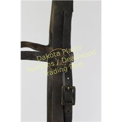 Complete original military bridle with U.S. No. 1 bit and copper rosettes in eagle shield pattern.