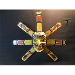 RANDY STIGLITZ, HAND CARVED AND PAINTED SEVEN RAY KWAKWAKWA SUN MASK, WITH IMAGES