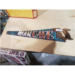 HAND PAINTED MANCAVE SAW