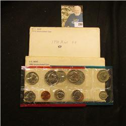 1974 & 1980 U.S. Mint Sets in original cellophane and envelopes.