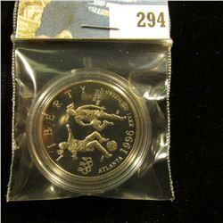 1996 S Proof 68+ Atlanta Olympics Soccer Commemorative Half-Dollar, encapsulated.