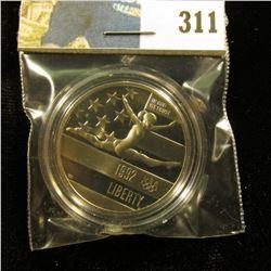 1992 S Olympics Gymnastics Proof 68+ Commemorative Half-Dollar, encapsulated.