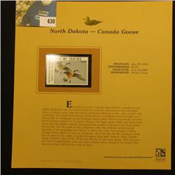 2001 North Dakota Waterfowl $6.00 Stamp depicting a pair of Canada Geese, Mint, unsigned, in vinyl p