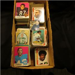 Double Row box full of old Football Cards dating from the late Sixties thru the early eighties.