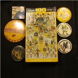 "(5) Different 1970-80 Hawkeye Homecoming Pin-backs; & an original wrapped VHS tape ""100 Years of Iow"
