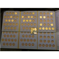 (2) Jefferson Nickel Blue Whitman folders, one of which has several nickels present.