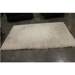 5 FOOT BY 8 FOOT WHITE SHAG AREA CARPET