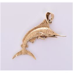 14kt yellow gold marlin pendant weighing 7.6