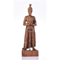 Vintage wood carved knight on guard holding a