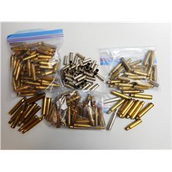 ASSORTED LOT OF BRASS CASES INCLUDING 35 REM,. 25,06 7MM-08 AND VARIOUS
