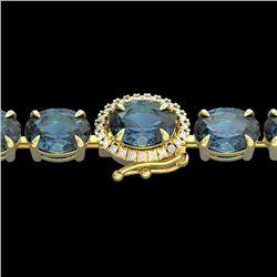 19.25 CTW London Blue Topaz & VS/SI Diamond Tennis Micro Halo Bracelet 14K Yellow Gold - REF-116T4X