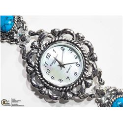 7) CONTINENTAL STAINLESS STEEL TURQUOISE WATCH
