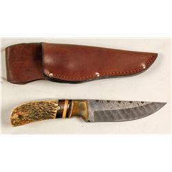 Custom made sheath knife with Damascus blade