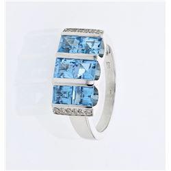 18KT White Gold 2.54ctw Blue Topaz and Diamond Ring