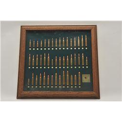 18BG-19 TATONKA CART. BULLET BOARDFramed Tatonka cartridge Co. bullet board  displaying cartridges f