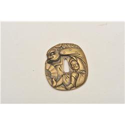 18CF-11 TSUBA BRASSFine and ornate Tsuba (Japanese sword guard)  brass alloy in ornate scene of man,