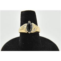 18RPS-19 SAPPHIRE & DIAMOND RINGOne ladies ring in 14k yellow gold set with a  marquee sapphire appr