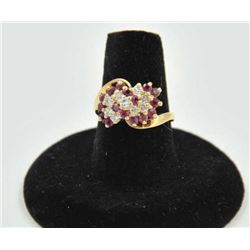 18RPS-20 RUBY & DIAMOND RINGOne ladies ruby and diamond cluster ring made  in 14k yellow gold EST:$3