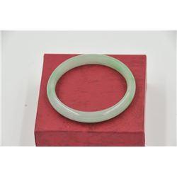 18RPS-39  JADE BANGLE BRACELETOne fine green jade bangle bracelet  EST:$150-300