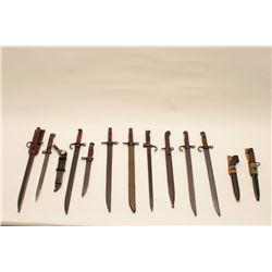 17MH-82 BAYONET LOTLot of 13 misc. military bayonets, most with  sheaths, including Japanese, Britis
