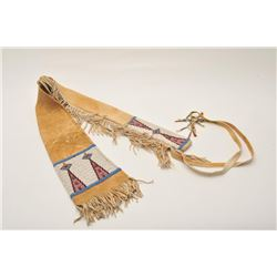 11AP-94 BEADED RIFLE CASEBeaded Indian tanned buckskin rifle case with  fringe and dangles; approxim
