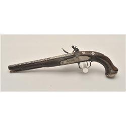 18AR-34 MID EASTERN FLINTLOCKMid-Eastern flintlock pistol, engraved with  fancy silver treatment to