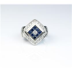 18CAI-44 SAPPHIRE & DIAMOND RINGStriking ring featuring a combination of Fine  princess cut Sapphire