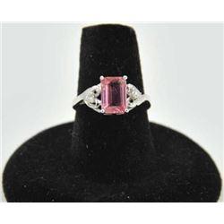 18PRS-11 TOURMALINE & DIAMOND RINGOne emerald cut pink tourmaline  approx 2ct  with 2 side diamonds