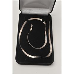 """17LP-17 SILVER NECKLACE23 ½"""" silver herringbone pattern necklace.   The necklace is in good overall"""