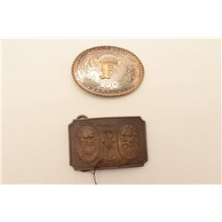 18AG-5 STERLING ENGRAVED BUCKLELot of two ornate metal belt buckles.  The  first is an engraved ster